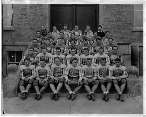 Schools - Niagara University<br /> Niagara University Football Team.<br /> Taps Gallahgher seated in the forth row hird from right, is pictured with NU football squad. Except for wartime service in the Navy, Coach Gallagher was on the Niagara scene from 1931 to 1969. He received honors for his sportsmanship whether winning (most of the time) or loosing.<br /> Photo - By L. J. Schira & Son.
