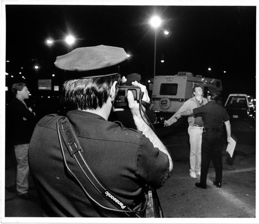 Police - Niagara Falls Police<br /> Officer Bob Mastrorilli videotapes officer Joe Marochi as he gives a bridge crosser a field sobriety at the Rainbow Bridge.<br /> Photo - By James Neiss 8/27/1988.