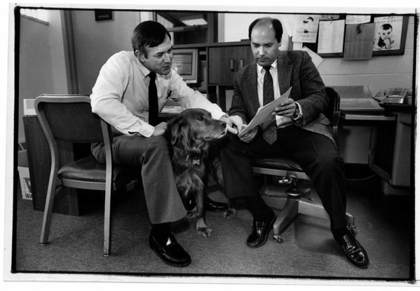 police - Scotch helps out at Niagara County Sheriffs Office.  From Left to Right<br /> Chief Phil R. Taber, Scotch and Investigator John Fink, go over some papers.<br /> Photo - by James Neiss 1/14/1991.