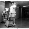 Hospitals - Niagara Falls<br /> Niagara Falls Memorial Medical Center<br /> Cleaning women Connie Salvo stands at her job in the jmedical center on 10th Street.<br /> Photo - By James P. McCoy - 8/30/1985.