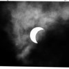 Weather - Eclipse<br /> Eclipse, the moon moves across the sun. the white in the picture around the moon is clouds.<br /> Photo - By Ron Schifferle - 5/30/1984.