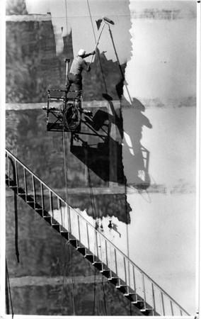 Industries - Ashland Petroleum Company<br /> Benito Mascduca of H & B Painting Company paints the Ashland Gasoline storage tank at the Ashland Patroleum Company Refinery on 4545 Rinf Road. Tonawanda.<br /> Photo - By James P. McCoy - 10/5/1985.