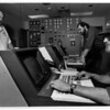 """Power - Southern Electric Int'l Cogenerator<br /> """"preparing to bring the faculty online""""<br /> From left to right: Peter R. Leighton, Plant manager looks on as Thomas Lockwood, shift leader (middle), and Mike Shepard, Control Room Operator (hat), work at the cogeneration plants controls.<br /> Frontier Ave., Niagara Falls.<br /> Photo - By James Neiss - 11/13/1991."""