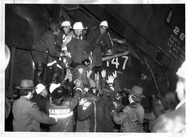 Railroads - 1976<br /> Passing down one of injured trainmen.<br /> Photo - By Al Shoen - 1/28/1976.