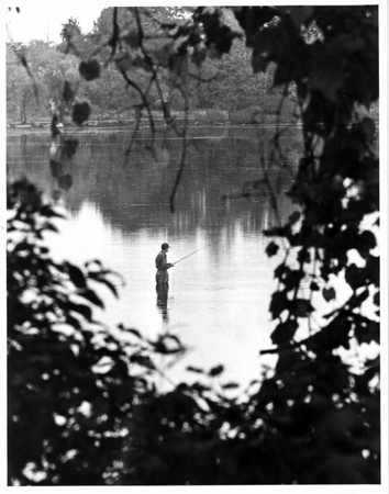 Bond Lake - Fishing<br /> A lone fisherman wades into Bond Lake on Lower Mountain Road, Lewiston to try his luck.<br /> Photo - By John Kudla - 10/10/1984.