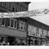 Entertainent - Peach Festival<br /> 1966 peach Festival banner Sponsored by the Kiwanis Club.<br /> The banner hangs over main street in Niagara Falls.<br /> Photo - Niagara Gazette - 8/10/66.