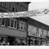 Entertainent - Peach Festival<br /> 1966 peach Festival banner Sponsored by the Kiwanis Club.<br /> The banner hangs over main street in Niagara Falls.<br /> Photo - Niagara Gazette - 8/10/66.