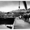 Military - Airforce jet<br /> An airforce jet is lifted by Higgins Erectors Haulers, Inc. onto a Barge at the West Canal Marina in Tonawanda, The Plane will travel by barge through the canal until it reaches the Empire State Aero Sciences Museum.<br /> Photo - By Elisa Olderman 10/19/1991.