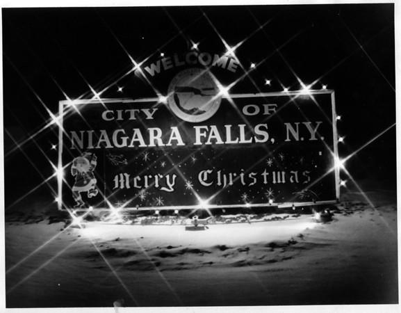 Christmas - Welcome<br /> Christmas welcome sign, welcoming tourists to Niagara Falls.<br /> Photo - By Niagara Gazette - 1/7/1976.