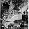 Christmas - Festival of Lights<br /> Snowing in the Rainbow Center.<br /> Dangling Christmas lights out of focus, give the impression that its snowing from the roof of the Rainbow Mall.<br /> Man - Sam Campagna (from Buffalo) - is waiting for his daughter to return from the food court. Daughter - Nicole (10 1/2 years old.)<br /> Photo - By Tim Johnson - 12/8/1986.