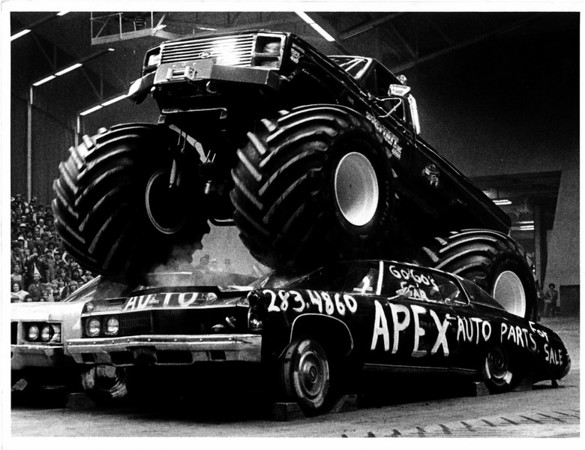 Convention Center - Bookings<br /> BIGFOOT<br /> Bigfoot - owned by Bob Chandler, driven by Ken Koelling, being driven over two cars at the Niagara Falls Convention Center.<br /> Photo - By Dan Shubsda - 11/04/1984.