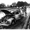 Fires - Lewiston<br /> Members of Lewiston Fire Co. #1 hose off the remains of a volkswagon bug after it burned on the Southbound lane of the Robert Moses Pkwy. in the Town of Lewiston.<br /> Photo - By John Kudla - 7/18/1985.