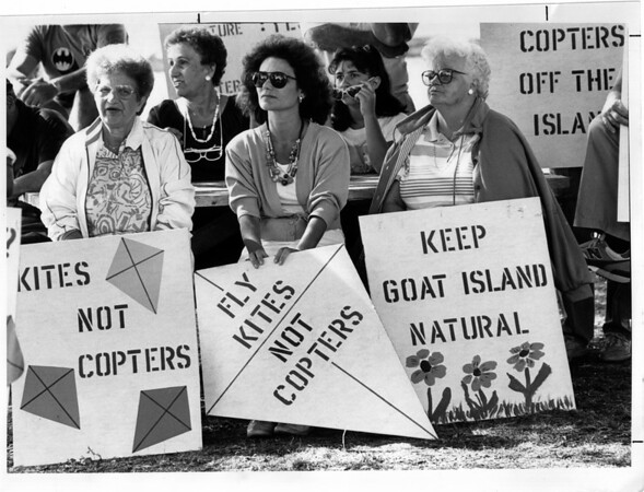 Helicopters - Goat Island<br /> From left to right Irma Chiodo, Carol Fleischman, and Isabel Deas all of Niagara Falls hold onto signs during a rally against the helicopter on Goat Island.<br /> Photo - By Melissa Mahan - 8/18/1989.