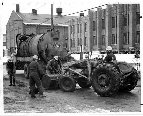 Industries - Frontier Chemical Waste<br /> From truck Frontier Chemical Waste suck it up while in front of Union Carbide Metals Division on Royal Ave.<br /> Photo - By Andrew J. Susty - 2/10/1981.