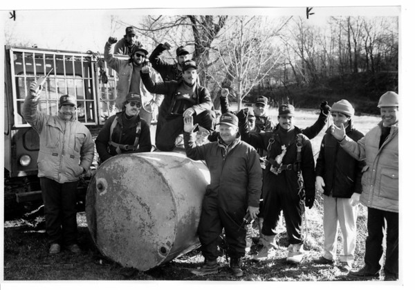 Niagara Falls, Barrel - Removing large barrel from American Falls, Workers with Emark Industries Inc. of Orchard Park and NY State Power Authority celebrate successful removal of a barrel from the brink of the Amercian Falls . 12/14/1990 Ron Schifferle Photo