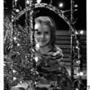 Christmas - Festival of Lights<br /> Close - up look at light diplay inside Wintergarden 2nd floor.<br /> Noelle Carl - 4 years old 925 McKinnley Ave. Niagara Falls.<br /> Photo - By Andrew J. Susty - 11/25/1981.