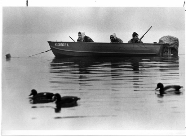 Hunting - Duck Hunting<br /> Duck hunting on the Niagara River<br /> From left to right, Wayne Coram, John Coram, and Jim Mettler. Went hunting today in the nIagara River for Golden Eye Ducks. The ducks shown in picture are decoy ducks.<br /> Photo - By James McCoy - 11/12/1985.