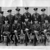 Police Niagara Falls - U.S. Border Patrol No.2. Niagara Falls.<br /> Sitting Left to right.<br /> R.J. Reagan = F.M. Tillotson, Chie Ins, A. Hainney = G.D. Albert, = C. Kohler = standing.<br /> Paul Roberts = Keneth Bennitt = R. W. Miller, = W. Stahl, = W. G. Wallace, = Arthur J. Becotte, = & R.. Doane.<br /> Photo by Ferguson. - Ft. Niagara
