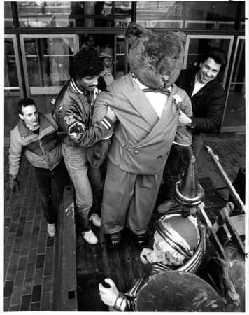 Christmas - Festival of Lights<br /> Decortions being removed from the Convention Center, after the Festival of Lights closed.<br /> From left to rigth Niagara County Employees- Chris Klinecko, Steve Ruiz, and Dennis Virtuoso.<br /> Photo - By Ron Schifferle - 1/10/1989.