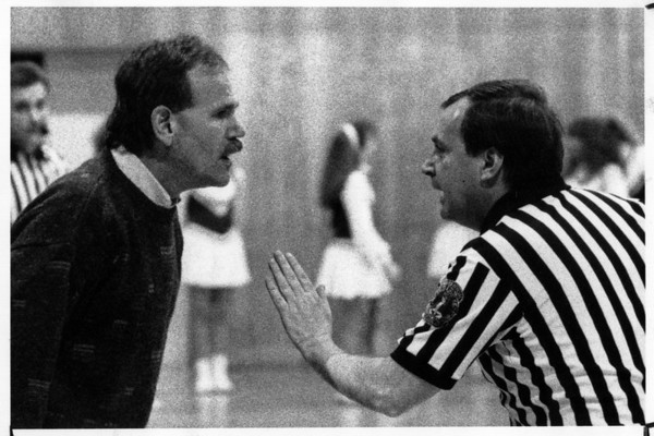Sports - Basketball<br /> Coach arguing with referee<br /> Photo - By Niagara Gazette - 3/17/1992.