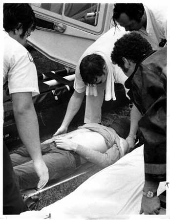 Niagara River - Raft Ride<br /> Deceased Male being placed in ambulance.<br /> Photo - Bt Dan Shubsda - 8/29/1975.