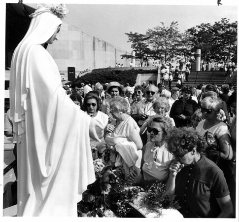 Convention Center Plaza<br /> People praying to the Virgin Mary before leaving the Rosary Crusade at E. Dent Lackey Plaza.<br /> Photo - By Melissa Mahan - 9/18/1988.