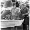 Airplanes - Cessna<br /> Border patrolman Stew E. Bryant, right, checks over the papers of 22 year old pilot William A Salton, of St Catherines, Ont after his single engine Cessna lost powers over Niagara Falls USA and forced him to make an emergency landing between Niagara River and Robert Moses Parkway near 4th Street on - ramp.<br /> Photo - By L. Massey - 9/7/1987.