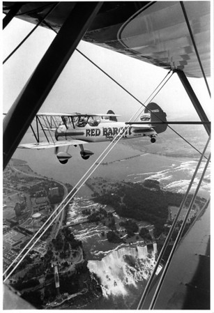 Airplanes - Red Baron BiPlane<br /> A Red Baron Biplane, carrying 1st time airplane passenger Patrina Wilson, of Buffalo permits a birds eye view of the American Falls for the 17 year old Children's Hospital of Buffalo patient.<br /> Photo - By L. Massey - 6/21/1987.