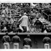 Baseball - Pilot Field<br /> Entertainment between innings by the Earl of Bud on yop of the Louisville Redbirds dugout, opening day of baseball at Pilot Field.<br /> Photo - By Ron Schrfferle 4/5/1989.