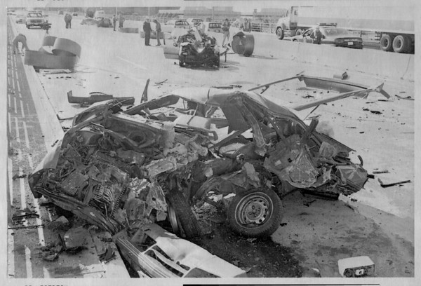 Police - Officials investigate wreckage along Interstate 190 in downtown Buffalo, N.Y. after an 18 wheel rig lost its load of coiled steel that crushed cars and their drivers during the morning rush hour. At least 4 people were killed.<br /> Photo - By Niagara Gazette - 10/5/1992.