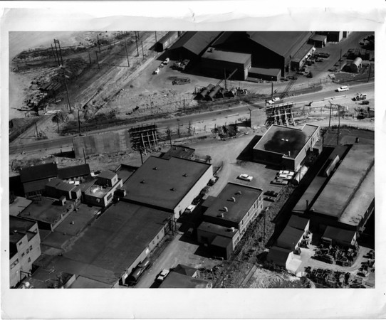 Streets - Urban Renewal.<br /> Pine Avenue under construction of over pass at 56th Street. Great Lakes Carbon in Background.<br /> Photo - By Leep Zelones (Aerial Photography).