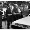 Police - on Walmore Rd. North of Rt. 31 on the Tuscarora Indian Res. Niagara County Sheriffs Dept. armed with shotguns looking for a suspect wanted in an early shooting.  (The suspect is John Jacobs)<br /> Photo - by Ron Schifferle 8/21/1990.