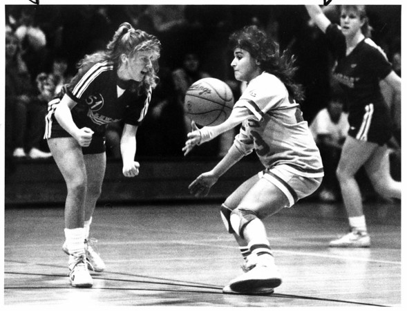 Christmas - Festival of Lights<br /> Festival of Lights basketball Tournament. Lewports #51 loses control of the ball but it bounced back to her off the arm of Niagara Falls High School's #23 (Julie) during the first quarter play.<br /> Photo - By Lisa Massey - 12/29/1987.