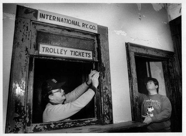 Railroads - North Tonawanda<br /> Geoff Gerstung, President of the Niagara Frontier Chapter of the National Railway Historical Society, left, and volunteer Jim Ball, right, scrape paint from the interior of the North Tonawanda Railroad Museum.<br /> Photo - By Elisa Olderman - 1/18/1992.