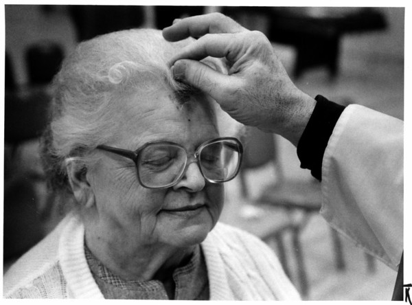 Churches - Ash Wednesday<br /> Mass and distribution of ashes at the Bishop Gibbons Apartments on Payne Ave in North Tonawanda by Ms. JOhn Kempczynski of St Joseph's Church.<br /> Theresa Richards a resident of the Bishop Gibbons Apartments receives ashes.<br /> Photo - By Ron Schifferle - 2/17/1988.