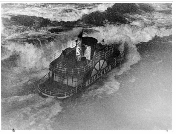 Niagara River, rescue? Lelawala - Riding out the rapids in the lower Nigara River the Lelawala as it passed under the Whirlepool Bridge on its trip through the rapids. 10/22/1986 Ron Schifferle Photo.