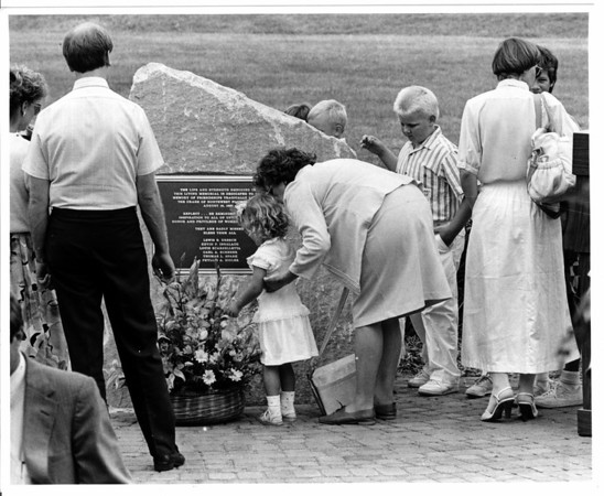 Airplanes - Northwest Airline Crash<br /> Dedication of living memorial to the 5 engineers who died one year ago in a Northwest Airline crash, they were all from Harrison Radiator.<br /> From left to right, Jordan Spark 2 years old daughter of Thomas L. Spark of Lockport and Lois Spark mother of Thomas L. Sopark.<br /> Photo - By Ron Schifferle - 8/15/1988.