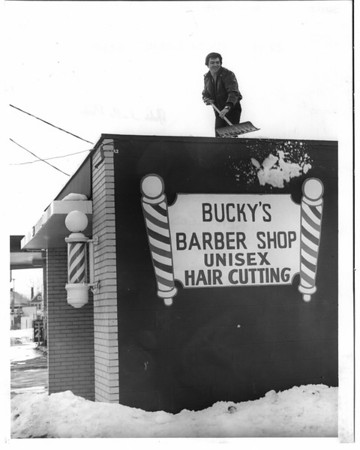 Buildings - Niagara Falls<br /> Bucky's Barber Shop Unisex Hair cutting<br /> 2216 Hyde Park Blvd.<br /> Ben Godile<br /> Photo - By John Kudla - 2/16/1982.
