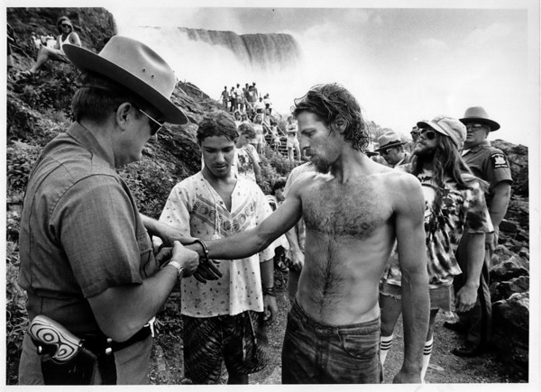 "Police - State Parks Police<br /> State Parks Police Officer Peter Boyd arrests two ""Dead Heads"" amoung many who went down into the river gorgr by the American Falls.<br /> Photo - By Melissa Mahan - 7/6/1989."