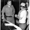 Niagara River - Rescues<br /> Officer Kenneth White of the Niagara Falls Parks Police discusses the incident with Stephen Socha, operator of the craft at the time.<br /> Photo - By Andrew J. Susty - 7/11/1977.