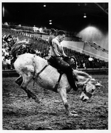 Convention Center<br /> Pete Mason rides Dixie, a bucking horse during bareback riding in the rodeo held at the Convention Center.<br /> Photo - By Elisa Olderman - 3/15/1991.