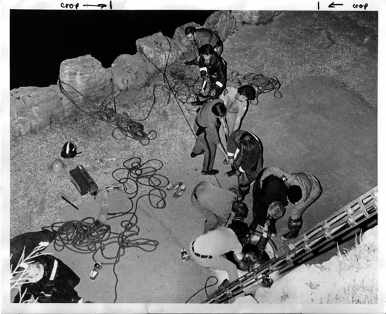 Niagara River Rescue - Pulling up one of the rescue people from shaft at old power plant. Mar 22, 1979.