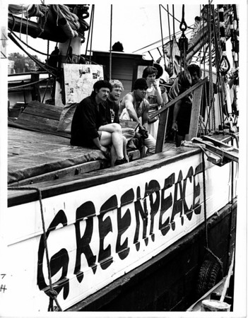 "Toxic Waste - Greenpeace<br /> The ship ""Fri"" at clock side Niagara on the Lake Ontario.<br /> Crew members from left to right - Gary Crosslin, USA (crew), Mark Jackson, USA (crew), Claus Bager Denmark (crew), and Joyce McLean with the Greenpeace movement in Toronto, Ontario.<br /> Photo - By Ron Schifferle - 6/7/1985."