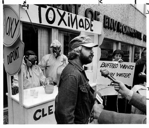 Toxic waste - Greenpeace<br /> Greenpeace protest in front of D.E.C. on Delaware Ave. in downtown Buffalo. They had a Toxiade stand set up with Toxic chemicals taken from a sewer near Durez plant in North Tonawanda.<br /> From left to right: Janet Abramovitz, Mark Osten, Marco Kaltophen, Greenpeace Northeast Coordinator, and Joyce McLean.<br /> Photo - By Ron Schifferle - 6/12/1985.