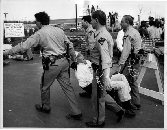 Organizations - Operation Rescue.<br /> Operation Rescue arrested in front of 2550 Sweet Home Rd. clinic of Dr. Shalom Press on his way to the school bus.<br /> Photo - By Ron Schifferle 4/22/1992.