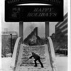 Convention Center Plaza - Parks Department.<br /> John Rucci of Niagara Falls, N.Y. and Parks Department shovels the steps in front of the Convention Center.<br /> Photo - By Bob Bukaty - 12/28/1982.