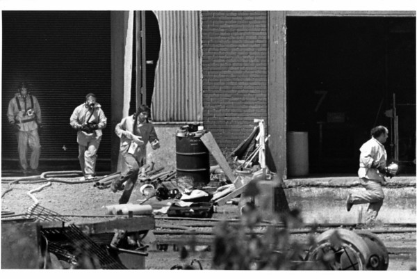 Industries - Niacet<br /> Niagara Falls Firefighters and Niacet personel run from the building after a chemical mixture caused poisonous fumes during the clean up at Niacet Chemical Plant on 47th Street, Niagara Falls. A 4000 gallon tank of chemicals laked.<br /> Photo - By Jamie Germano - 6/18/1987.