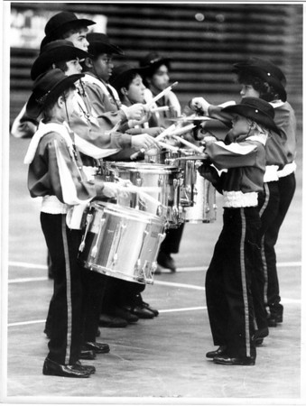 Convention Center<br /> Convention of Bands<br /> The Getzville Drum and Twirl Corp. perform at the Niagara Falls Convention Center in the Floor Corp. Competition.<br /> Photo - By James P. McCoy - 8/10/1986.