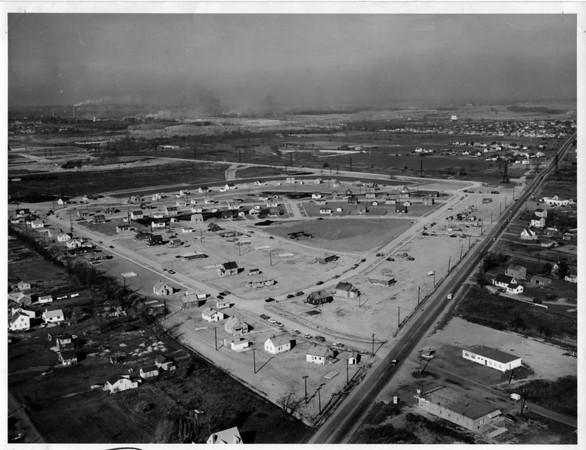 Power Companies - Niagara Power Project<br /> Aerial view of the house relocation area looking approximately Northwest and showing Military Road.<br /> Photo - By Power Authority of the State of New York - 10/21/1958.
