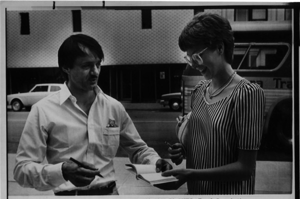 Niagara River - Stunters<br /> Karel Soucek<br /> Karel Soucek, the Hamilton, Ontario resident who went over Niagara Falls in a barrel on 7/2/1984, stops to sign an autograph for Maureen Harkness of Orangevill, Ontario as he makes his way into Niagara Falls, Ontario Provincial Court for a hearing on his charges of unlawully performing a stunt in the park. Soucek was fine $500.00.<br /> Photo - By Mike Beecher - 7/11/1984.